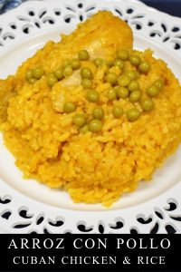 Arroz con pollo served on a white plate.