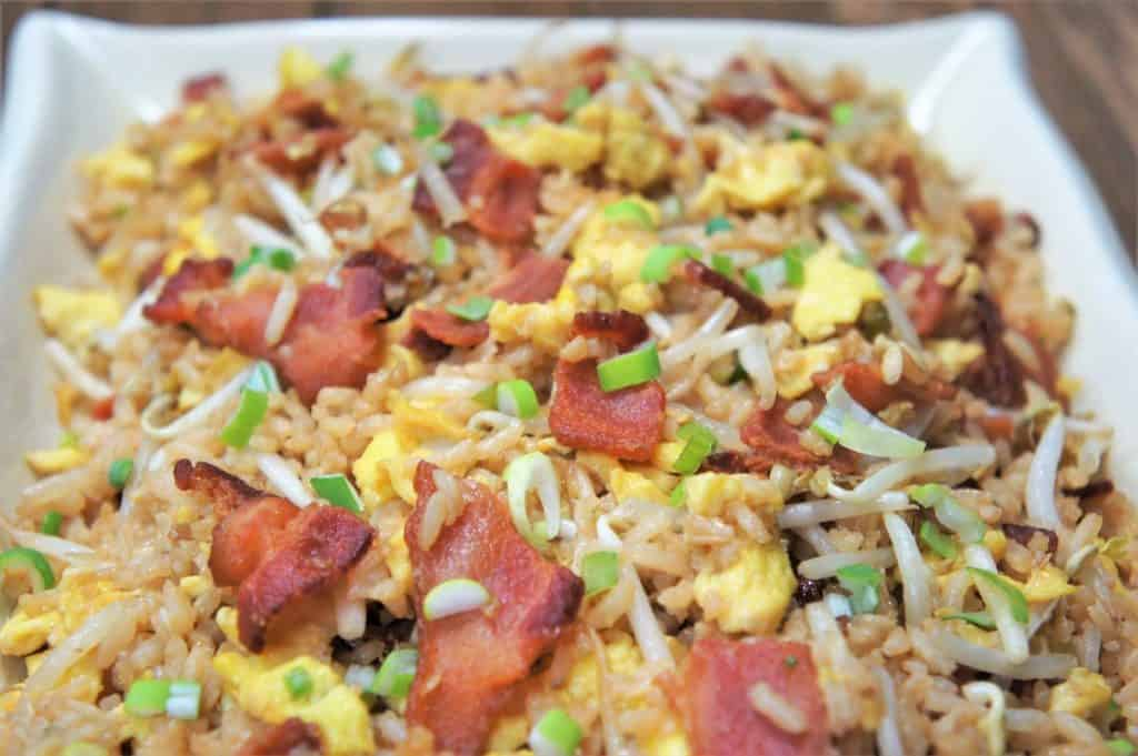 Bacon and Eggs Fried Rice served on a white platter.