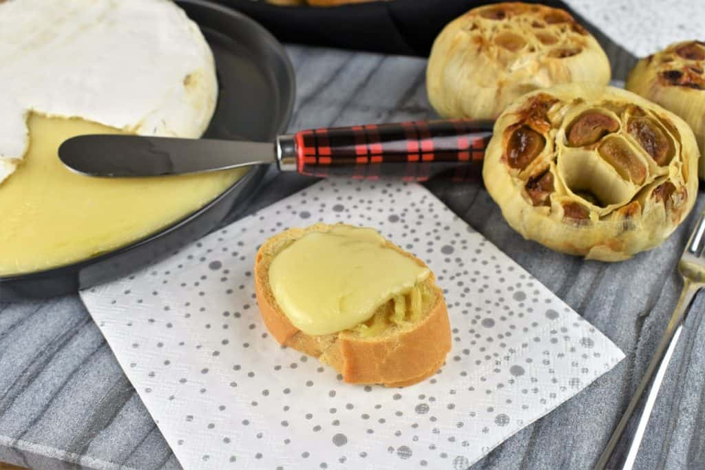 Baked Brie and Roasted Garlic served on a toasted baguette round