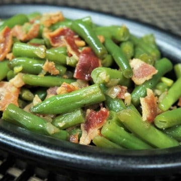 Green Beans & Bacon served in a black oval bowl