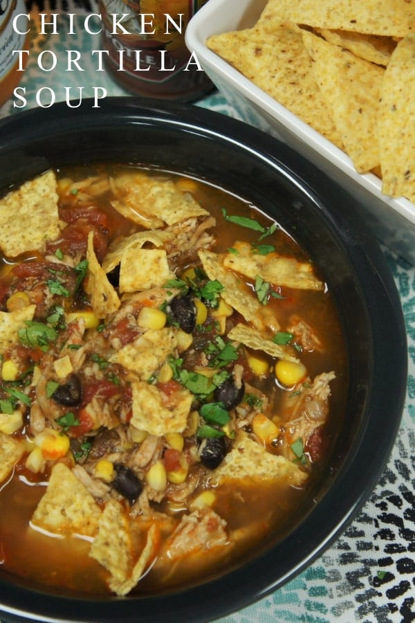 This chicken corn tortilla soup is budget friendly, easy to make and it's delicious! Cut down the cooking time by using leftover chicken, store bought rotisserie, or poach some chicken breasts, either way, super easy. #chickencorntortillasoup #soup #chicken #easydinners #southwestern #mexican