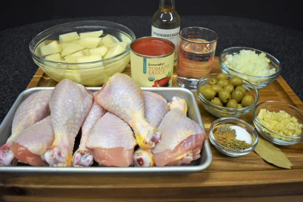 The ingredients for chicken fricassee displayed on a wood cutting board