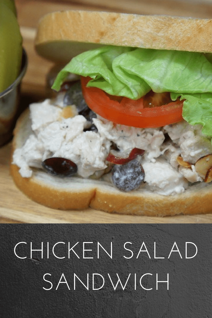 A light lunch is perfect on a hot day, and this chicken salad sandwich is just the thing. Poached chicken breast, toasted almonds and sliced grapes are combined with a slightly sweet dressing to create the perfect chicken salad. Serve the chicken salad on your favorite bread, with a bowl of soup or, eliminate the bread altogether and add a heaping scoop on a bed of lettuce. #chickensaladsandwich #chickensalad #chicken #lunch #lunches