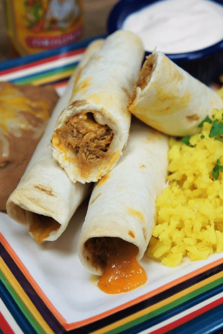 These shredded chicken taquitos are perfect for dinner or as an appetizer. Chicken is cooked in a tomato sauce that's seasoned with a southwestern inspired spice blend. Then the chicken is shredded and added back to absorb the sauce. We use flour tortillas to wrap the chicken add cheese, then bake them until crispy. #chickentaquitos #taquitos #chicken #Mexicanfood #southwestern #appetizers #gamedayappetizers