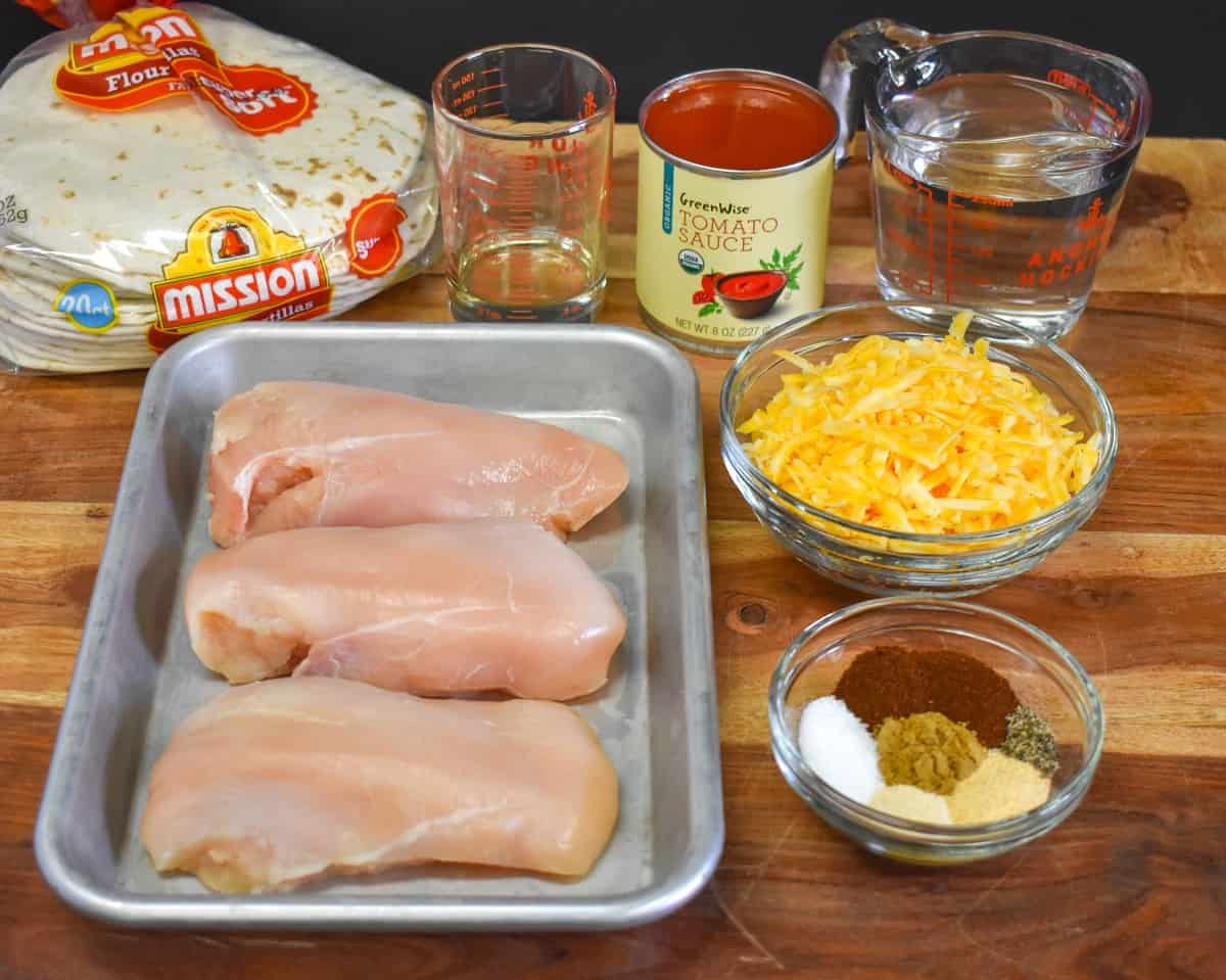 The prepped ingredients for the dish arranged on a wood cutting board.