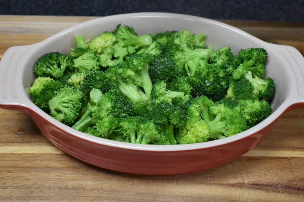 Cooked Broccoli in a red casserole dish
