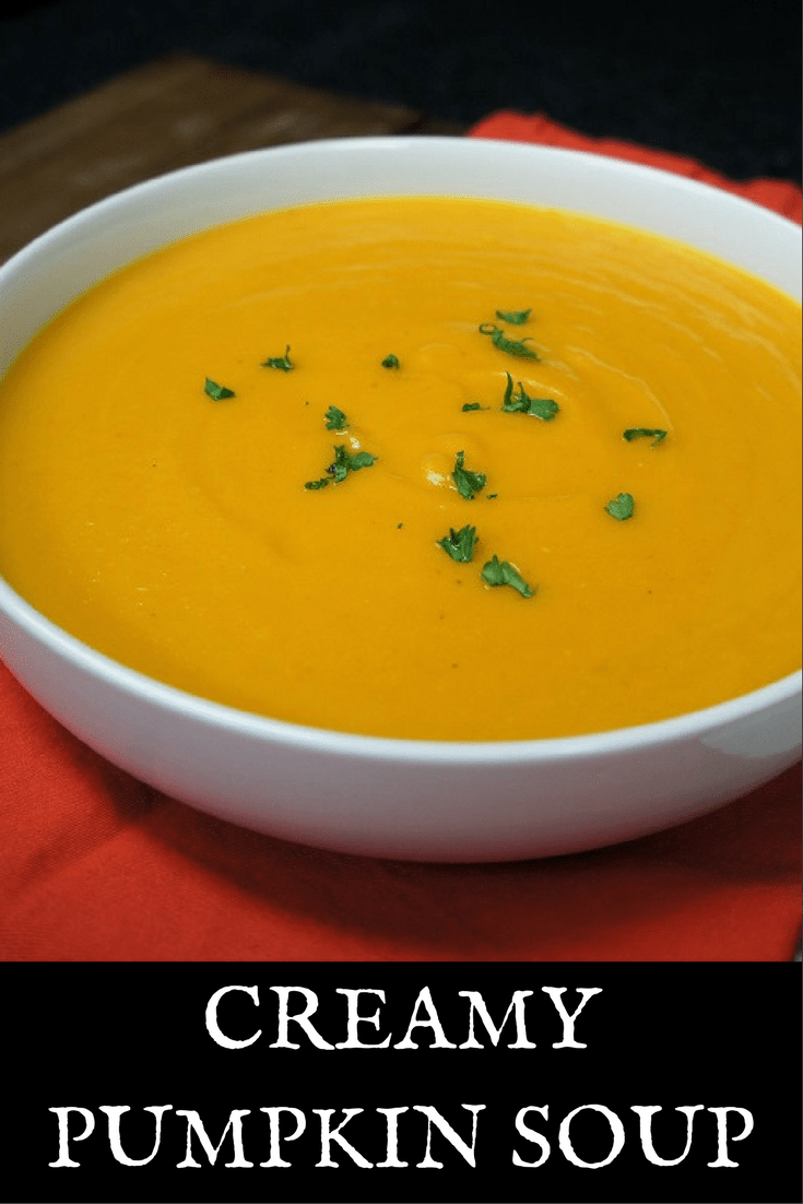 This Creamy Pumpkin Soup is loaded with good-for-you veggies and spices, with just a little bit of bacon and cream to keep things fun. It's really easy to make, and doesn't take too long. It's a perfect starter soup, or serve it with a big piece of crusty bread for a light dinner. #creamypumpkinsoup #pumpkinsoup