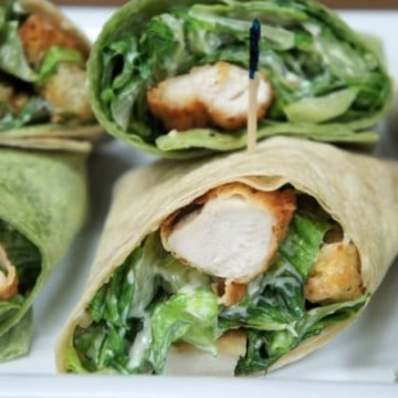 Crispy Chicken Caesar Salad Wraps chopped breaded chicken combined with Caesar salad rolled in thin wraps, cut in half and secured with toothpicks