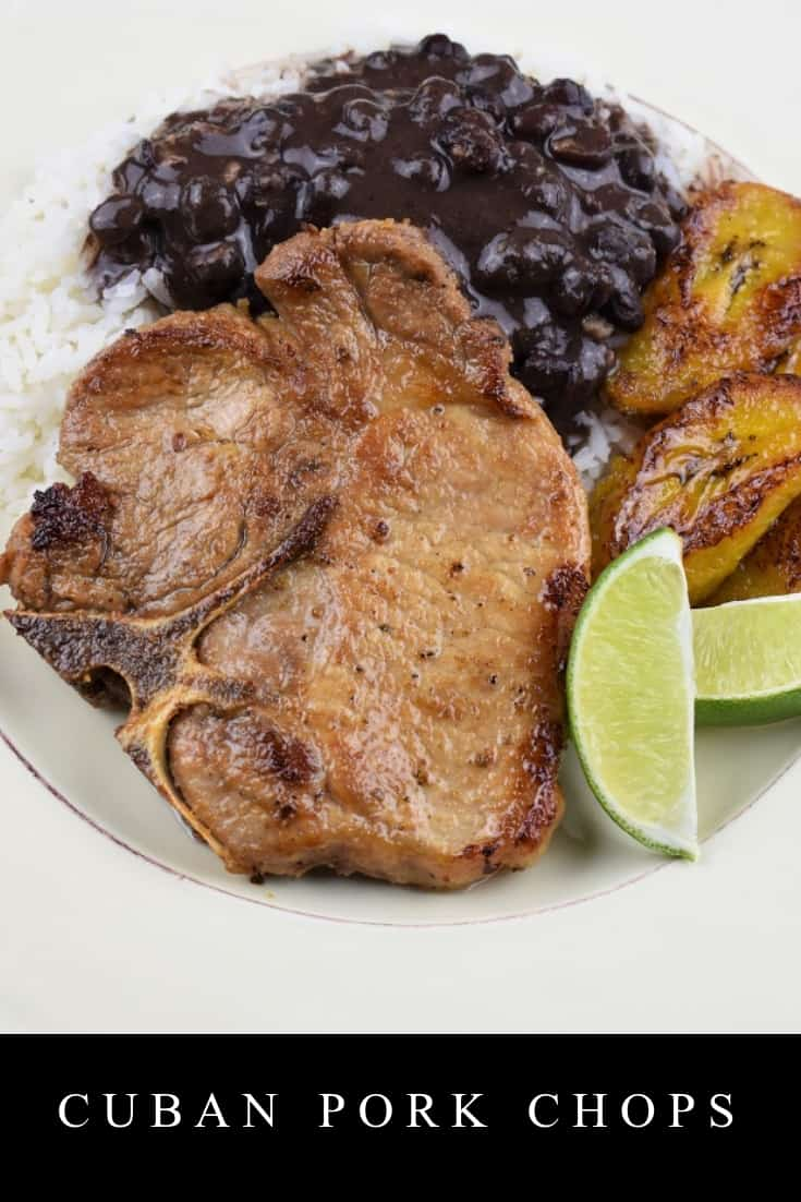 These Cuban pork chops or chuletas de cerdo in Spanish, make an easy, affordable and quick dinner. In this recipe, thin-cut pork chops are seasoned with garlic powder, cumin, oregano and salt and pepper. Then we squeeze some fresh lime juice over them and let them marinate for great flavor. Serve the pork chops with white rice and black beans or mashed potatoes for a filling and delicious meal. #cubanporkchops #porkchops #Cubanfood