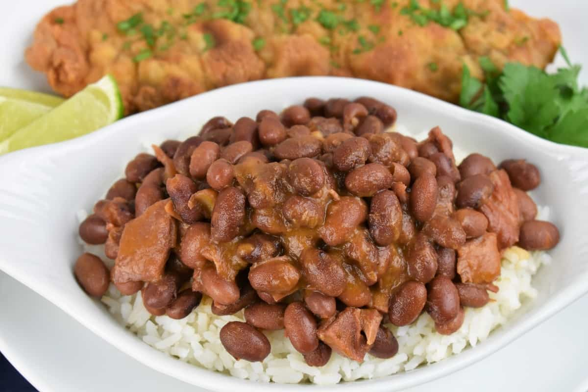 A close-up of Cuban Red Beans served over white rice