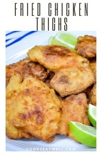 Fried Chicken Thighs served with lime wedges.