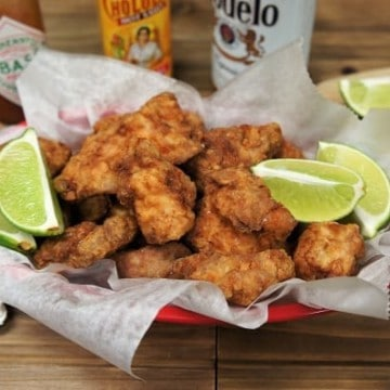 Fried Pork Chunks, served in a basket with lots of lime wedges and hot sauce