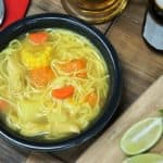 Cuban Chicken soup with noodles carrots, pumpkin, corn and other vegetables
