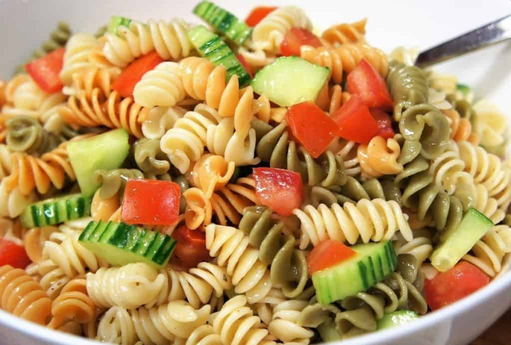 Garden Pasta Salad colorful rotini pasta with diced tomatoes and cucumbers served in a large white bowl