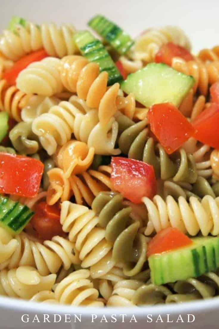 This garden pasta salad is easy to make and comes together quickly. Made with tomatoes, cucumbers and a light oil and vinegar dressing, this pasta salad is the perfect side dish for summer. #gardenpastasalad #pastasalad #pasta #summersalads #coldpastasalads #partyfood