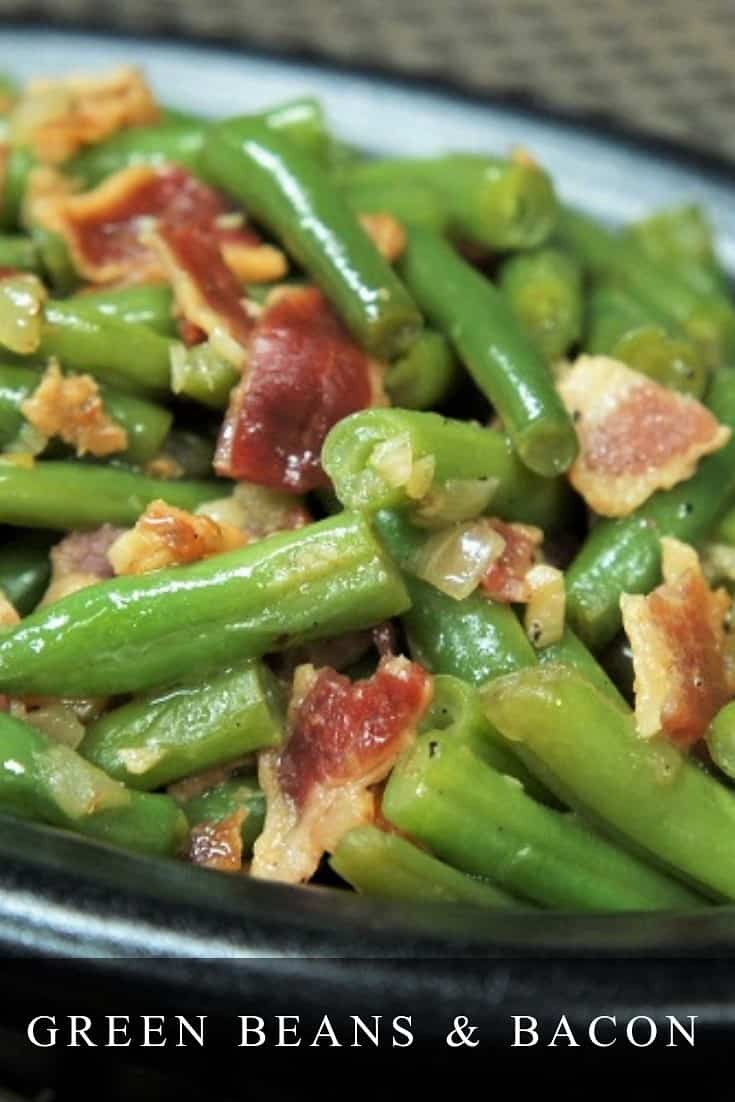 If you're looking for a delicious and easy-to-make side dish, these Green Beans & Bacon are just the thing. In this recipe, onions and garlic are gently sautéed in butter. Then we add fresh green beans, crispy bacon, and gently cook them with a little bit of beef broth until they're perfectly tender. #greenbeansandbacon #greenbeans