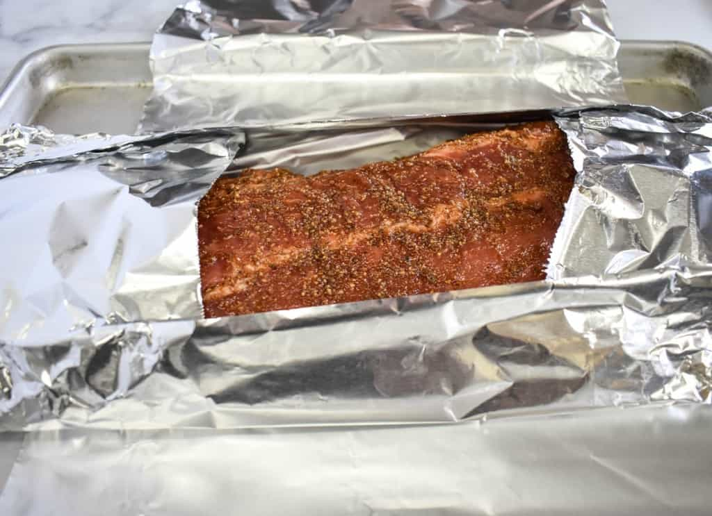 The ribs half covered with the foil with only the center part exposed.