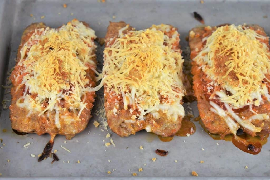 Italian Sausage Parmigiana on a metal baking sheet and baked