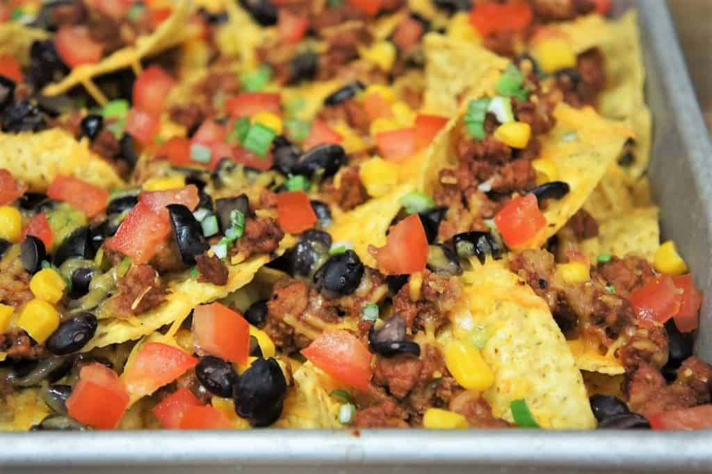 A close up image of loaded nachos.