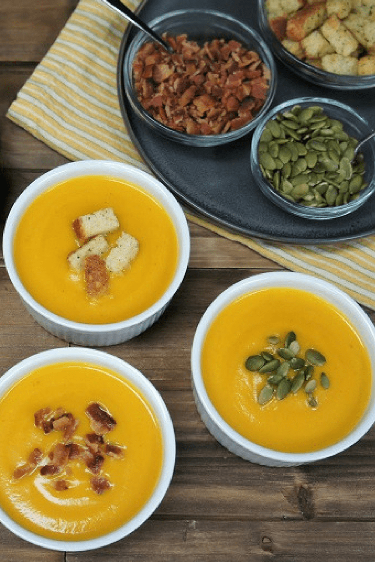 This pumpkin and apple soup is absolutely delicious and really easy to make. It's loaded with good-for-you ingredients too. Pumpkin, apples, onions, carrots, celery and garlic all come together to make a creamy and satisfying soup. #pumpkinapplesoup #pumpkinsoup #pumpkin #apples #soups #autumn #fallfood