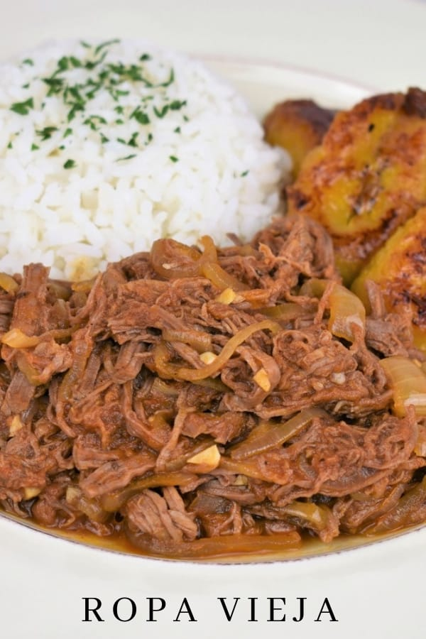"""Ropa Vieja is a traditional Cuban dish that's easy to make and delicious. The literal translation of ropa vieja is """"old clothes"""". It's called this because the shredded beef resembles tattered, old clothes. What it actually is: Steak, usually flank, that's boiled, shredded and cooked in a flavorful tomato sauce. #ropavieja #shreddedbeef"""