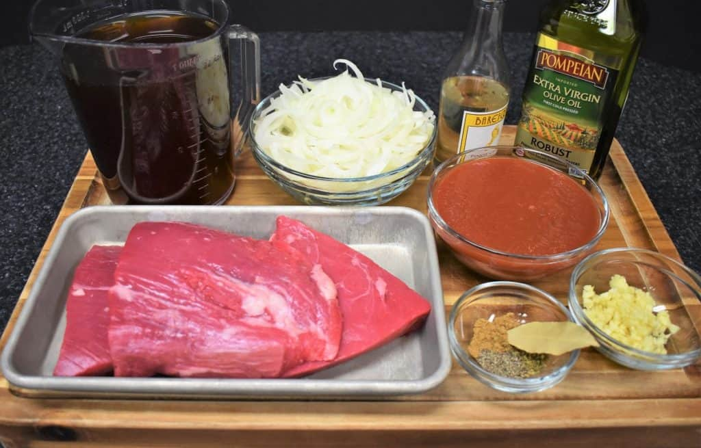 Ropa Vieja ingredients, prepared and arranged on a wood cutting board