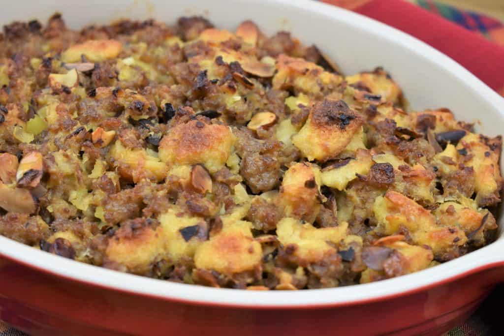Sausage Stuffing served in a red casserole dish