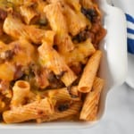 A close up image of the southwestern pasta in a white casserole dish.