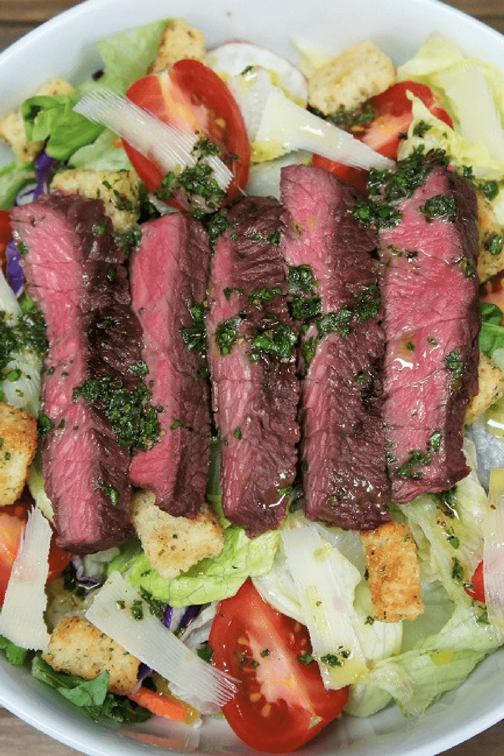 This steak salad & chimichurri dressing is an easy and quick way to get dinner on the table on busy weeknights. The steak makes this salad a meal, and the chimichurri dressing makes it special. #steaksalad #salad #chimichurri #homemadedressing #steak #grilledsteak #summersalads #summertimemeals