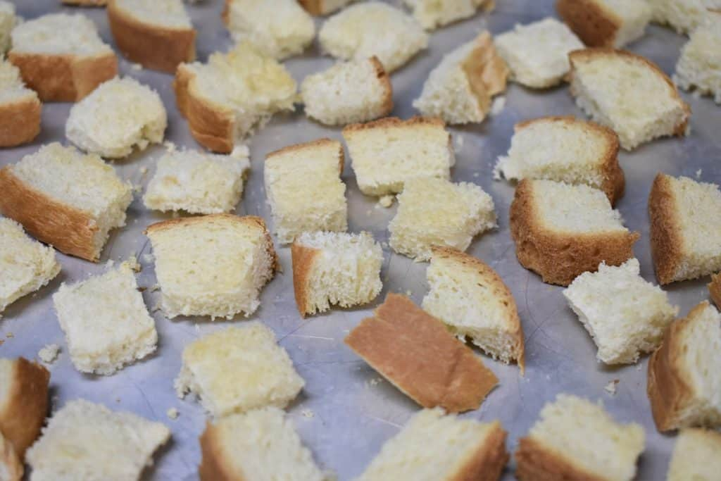 Toasted Bread for Sausage Stuffing arranged on a sheet pan