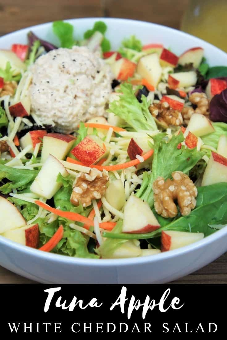 Forget boring salads, this tuna apple white cheddar salad is loaded with delicious and filling ingredients. This salad starts with a bed of lettuce, then we add a light, yet creamy tuna salad. For some crunch, there's walnuts and shredded carrots. White cheddar cheese adds even more flavor and a creamy touch. Top it all off with a homemade apple cider vinaigrette and you'll have a salad you will look forward to eating. #tunasalad #salad #tuna #lunch #lentrecipes #lent