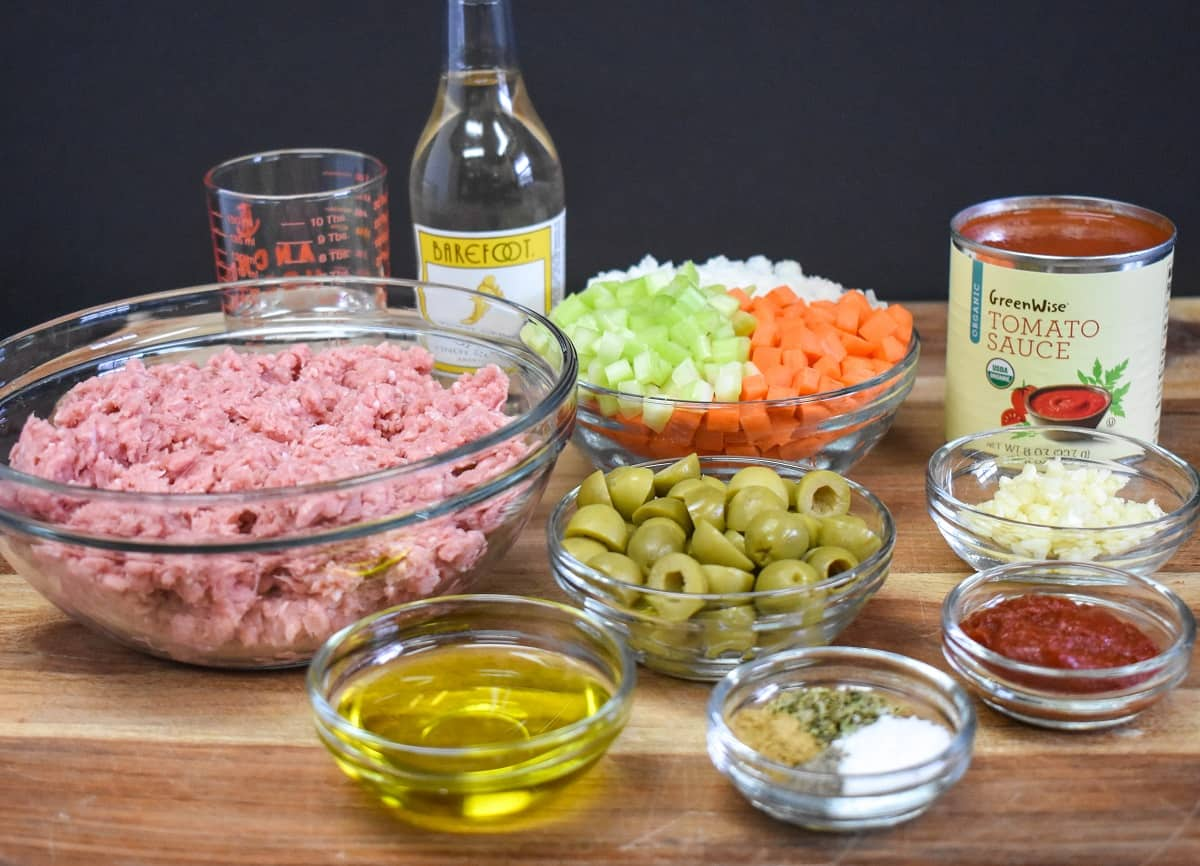 The ingredients for turkey picadillo, prepped and separated in glass bowls.