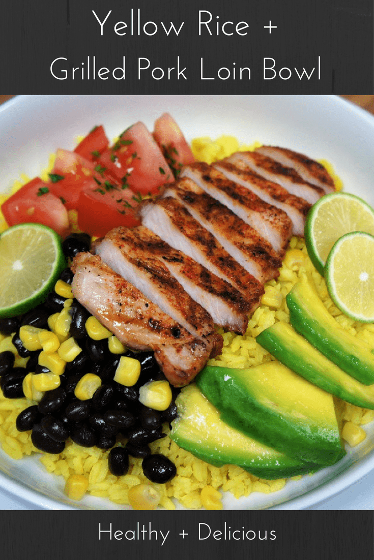Yellow rice made with turmeric, topped with grilled pork loin chops, fresh tomatoes, avocado, corn and fresh lime juice all in one healthy, filling, delicious bowl. #porkloin #porkloinchops #yellowrice #porkricebowl #bowls #healthydinner
