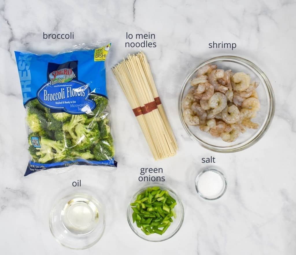 The ingredients for the lo mein without the sauce arranged on a white table.