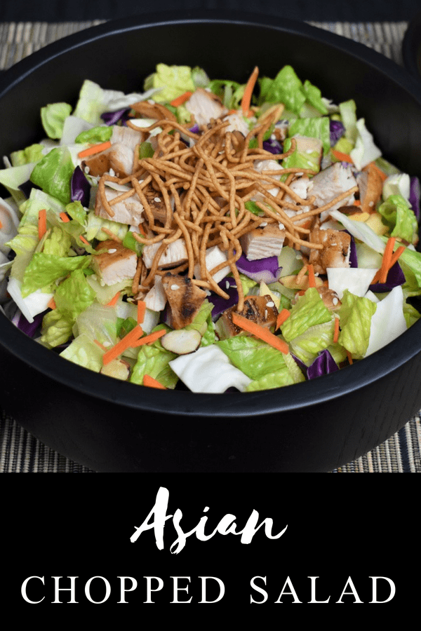 This Asian chopped salad is a crisp, fresh and filling. It's great for lunch or a light dinner. Green and red cabbage are combined with romaine lettuce, carrots and green onions. Then it's topped with grilled chicken, toasted almonds, rice noodles and sesame seeds. #Asianchoppedsalad #choppedsalad #cabbagesalad #cabbage #salads #lunchsalad