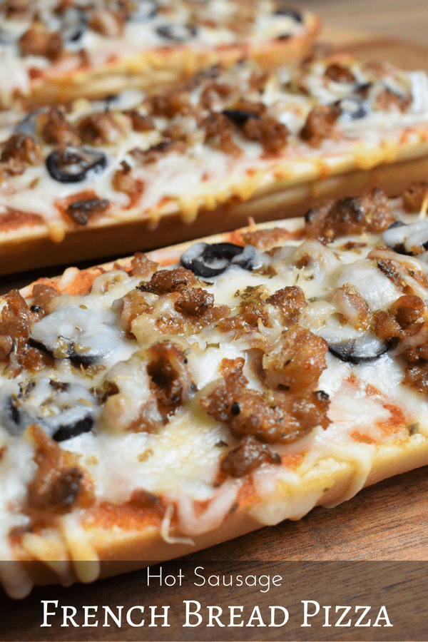 This hot sausage French bread pizza is an easy and delicious dinner for busy weeknights, movie night or game-day. French bread is topped with olive oil, marinara sauce, mozzarella cheese, hot Italian sausage, sliced onions and black olives. #frenchbreadpizza #hotitaliansausage #hotsausage #homemadepizza #gamedayfood #easydinner #pizza