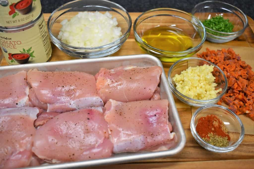 The ingredients for pollo en salsa recipe displayed on a cutting board.