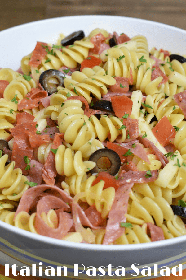 This Italian pasta salad is easy to make and delicious. It comes together quickly and the only cooking involved is making the pasta. Make it extra special with a homemade Italian dressing that's just as easy to make. This is a great dish for picnics and summertime parties. #Italianpastasalad #pastasalad #summersides #summertime