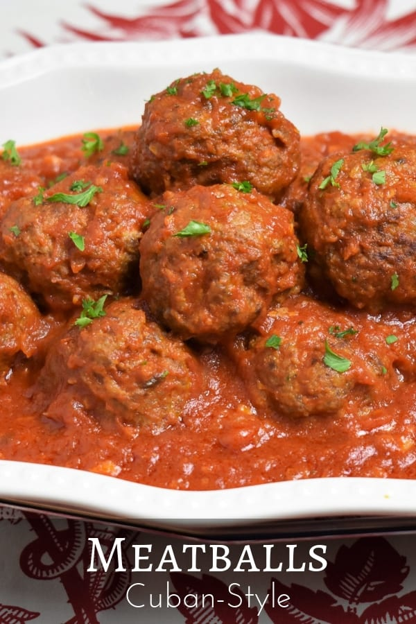 Meatballs Cuban style, this is how we had meatballs at my house, not over spaghetti but on a bed of white rice. In this recipe, the meatballs are seasoned with a combination of traditional Cuban spices – garlic powder, cumin, oregano, finely diced onions and parsley. #meatballs #Cubanfood #Cubanrecipes #groundbeef