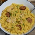 Yellow Spanish Rice with chicken and sausage served in a bowl