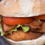 Crispy Chicken BLT, a breaded and fried chicken cutlet topped with bacon, lettuce and tomatoes served on a sandwich bun