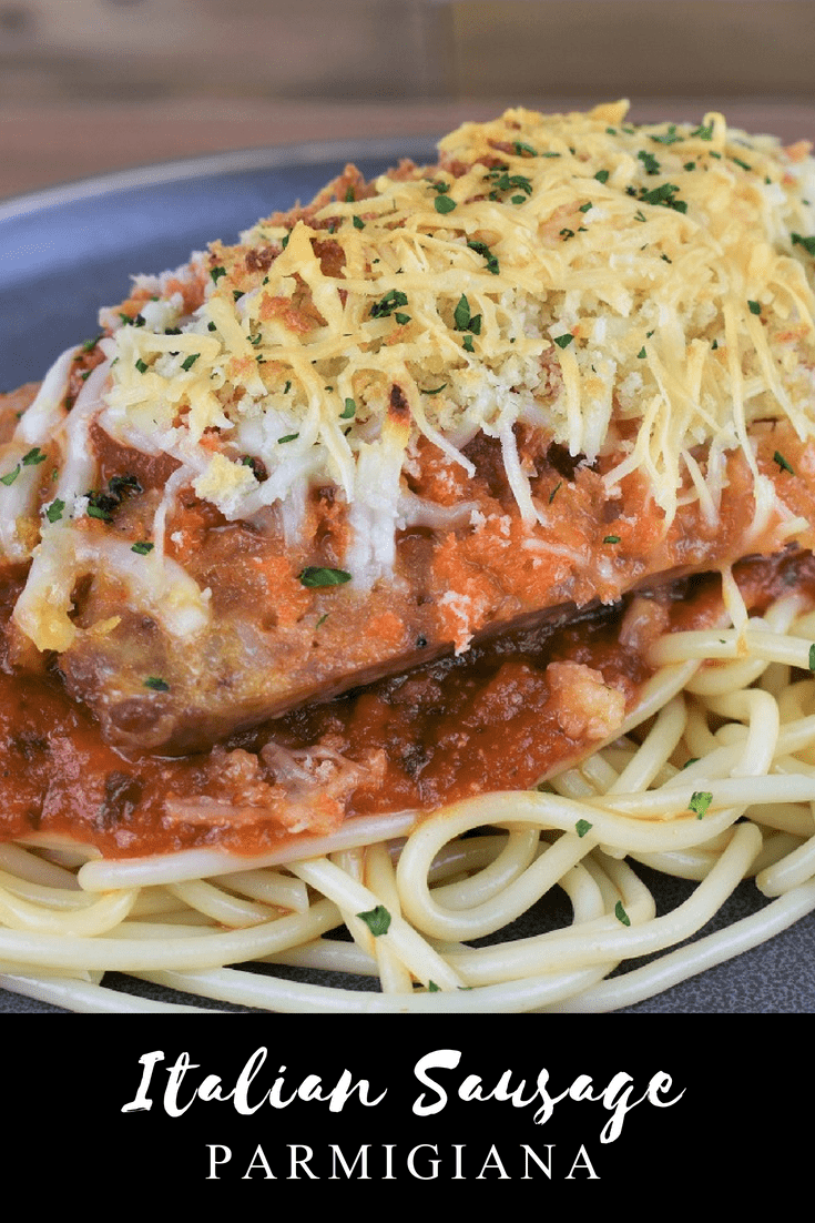 Italian Sausage Parmigiana, for this dish, flavorful Italian sausage is topped with pasta sauce, mozzarella and Parmesan cheeses and crunchy breadcrumbs. Then it's served on top of a bed of pasta, for a fun take on traditional Parmigiana. #Italiansausageparmigiana #Italiansausage #sausage #easydinners #pasta #parmigiana