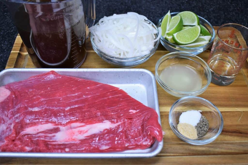 The ingredients for vaca frita arranged on a cutting board.