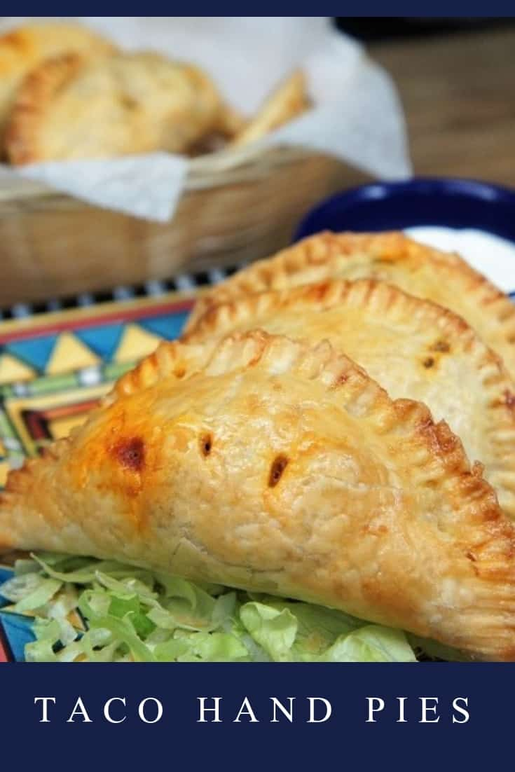 These hot and flaky, hand pies are filled with a delicious and flavorful taco filling. We use ground turkey that's seasoned with a southwestern-inspired seasoning blend, black beans, corn and just a little bit of Monterey Jack cheese and green onions. #tacohandpies #tacos #handpies #Mexicanfood #southwestern #taconight