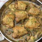 Braised Chicken Thighs with mushroom garlic sauce in a large skillet