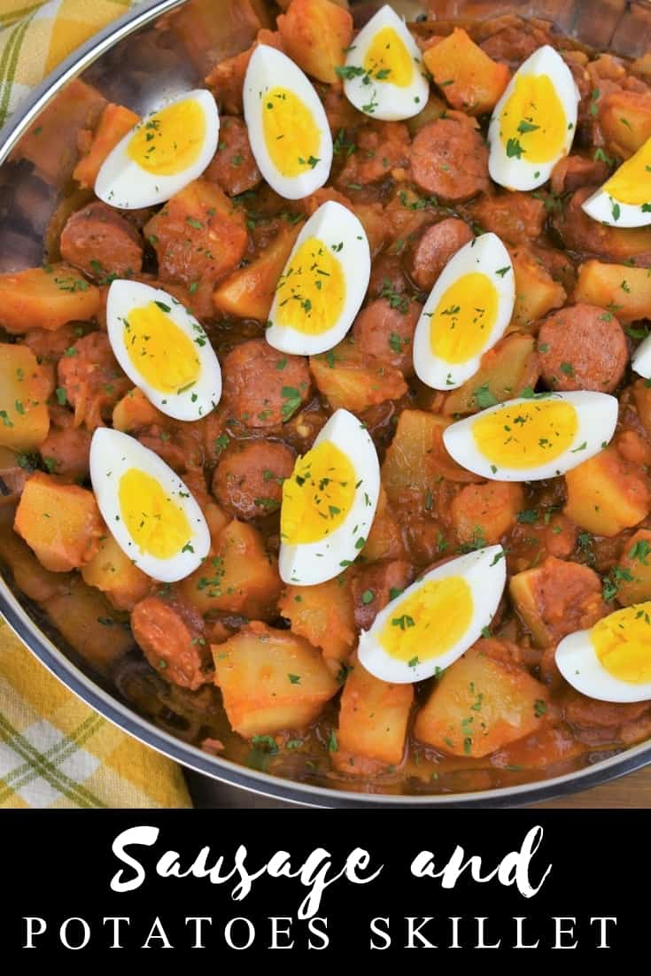 This sausage and potatoes skillet is easy, affordable and delicious, a winning combination for weeknight dinner! In this recipe, fully cooked sausage is simmered in a flavorful tomato sauce with potatoes. Then, to make it extra filling, it's topped with hard boiled eggs. Serve this meal with crackers or bread to soak up the delicious sauce. This is a no-fuss comfort food meal that's perfect for tight-budgets and cold nights! #sausageandpotatoes #easysausagedinner
