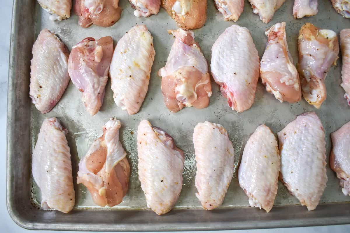 The chicken arranged on a large baking sheet.