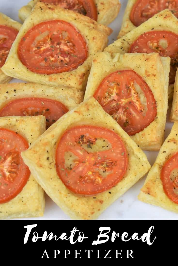 Tomato bread, or pan con tomate, is a Spanish dish, usually served as an appetizer, or snack. It's  toasted bread that's rubbed with a garlic clove and topped with olive oil, tomatoes and salt. In this recipe we take a simple pan con tomate and dress it up for a party. Instead of crusty bread, we use flaky puff pastry, brushed with a butter, olive oil and garlic spread. Then topped it with tomato slices and baked until golden. #tomatobread #pancontomate #appetizers