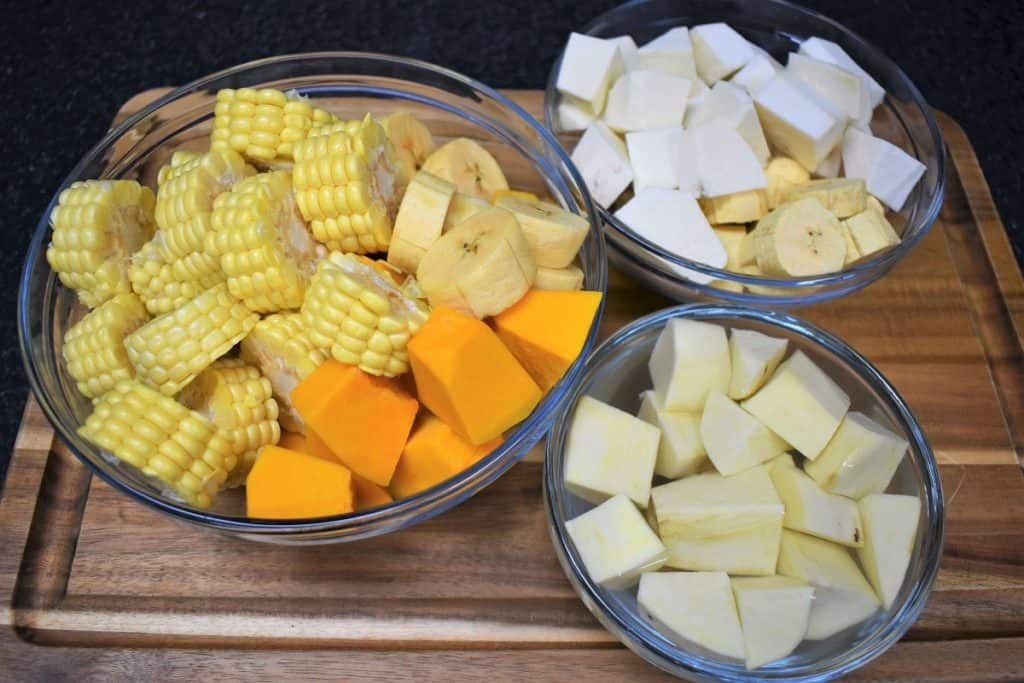 Chopped Vegetables for Ajiaco soup separated in glass bowls