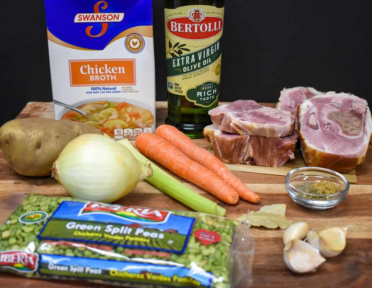 The ingredients for the split pea soup displayed on a wood cutting board.